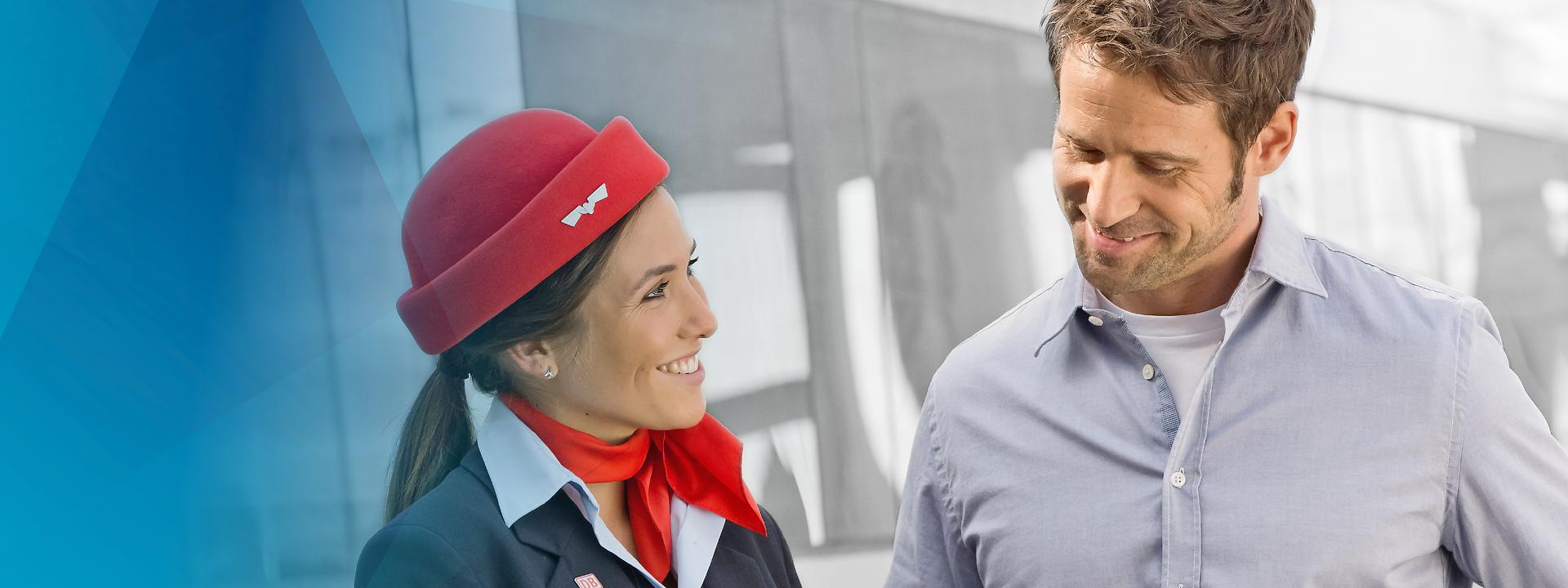 DB Systel Mobile Solutions - DB Mitarbeiterin hilft Reisendem
